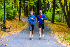 Couple running, jumping outdoor Stock Images