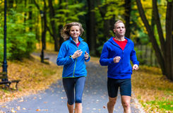 Couple running, jumping outdoor Stock Image