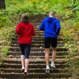 Couple running, jumping outdoor Stock Photos