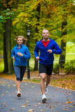 Couple running, jumping outdoor Stock Photography