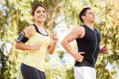 Couple running and listening to music Stock Photo