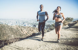 Couple running in los angeles Royalty Free Stock Images