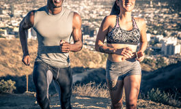 Couple running in los angeles Royalty Free Stock Photos