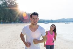 Free Couple Running Man And Woman Sport Runners Jogging On Beach Working Out Smiling Happy Fit Male And Female Fitness Jogger Royalty Free Stock Photography - 101002987