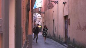 Couple running on the old streets stock video footage