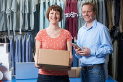 Couple Running Online Clothing Business. Couple Running Online Clothing Store From Warehouse Stock Photo