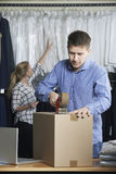 Couple Running Online Clothing Store Packing Goods For Dispatch Stock Images