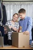 Couple Running Online Clothing Store Packing Goods For Dispatch Royalty Free Stock Image