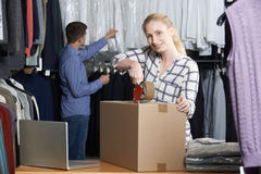 Couple Running Online Clothing Store Packing Goods For Dispatch. Couple Running Online Clothing Store Packing Goods Stock Images