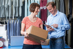 Couple Running Online Clothing Store Together. Couple Running Online Clothing Store From Warehouse Stock Photo