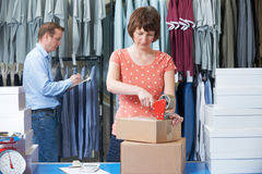 Couple Running Online Clothing Store. From Warehouse Royalty Free Stock Photo