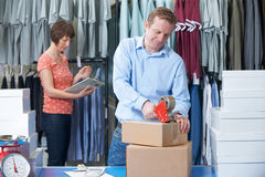 Couple Running Online Clothing Store. From Warehouse Stock Images