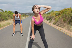 Couple running on the open road together Stock Images