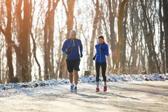 Couple running outdoor royalty free stock photo