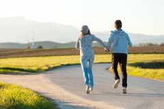 Couple Running Outdoors. Stock Photo
