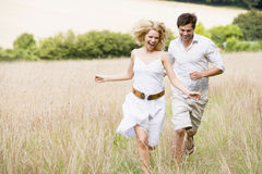 Couple running outdoors Stock Photography