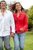 Couple running outdoors Royalty Free Stock Images