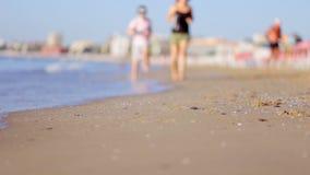 Couple Running Outdoors on Beach. stock footage