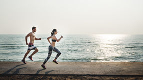 Couple Running Outdoors Beach Concept Stock Image