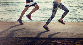 Couple Running Outdoors Beach Concept Royalty Free Stock Image
