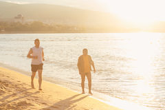 Couple Running Outdoors on Beach Stock Image