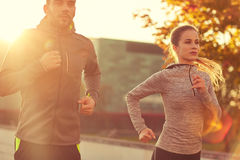 Couple running outdoors Stock Images