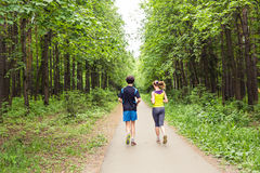 Couple running outdoors. Woman and man runners jogging together outside in full body length. royalty free stock photography