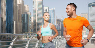 Couple running over dubai city street background Royalty Free Stock Photos