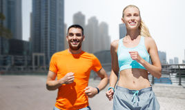 Couple running over dubai city street background Stock Photo