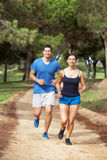 Couple running in park. And looking forwards Stock Photo