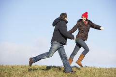 Couple Running In The Park. Laughing Stock Images