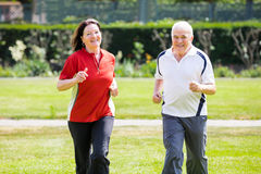 Couple Running In Park Royalty Free Stock Images
