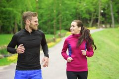 Couple running in park Royalty Free Stock Image