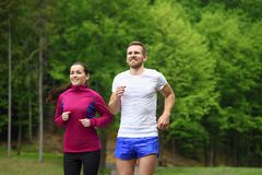 Couple running in park Royalty Free Stock Photos