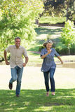 Couple running in park Stock Images