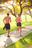 Couple running in park Stock Photo