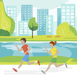 Couple Running in the Park Stock Images