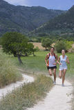 Couple running on rural path royalty free stock image