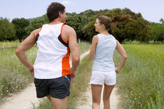 Couple running on rural path royalty free stock images