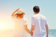 Couple running on a sandy beach Royalty Free Stock Photos