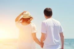Couple running on a sandy beach Royalty Free Stock Photos