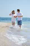 Couple running on a sandy beach stock images