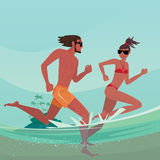 Couple running in shallow water. Happy romantic young couple in swimsuits that running together in shallow water. Split view of over surface and underwater Royalty Free Stock Photography