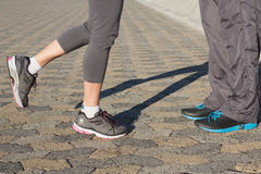 Couple in running shoes facing each other Royalty Free Stock Images