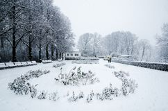 A couple running during a snow fall in Vigeland Park in Oslo royalty free stock photos