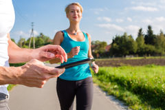 Couple running, sport jogging on rural street Stock Photos