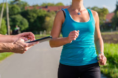 Couple running, sport jogging on rural street Royalty Free Stock Photo