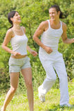 Couple running together Stock Images