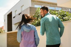 Couple running together. From back. Cheerfully young couple in city Stock Image
