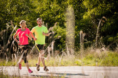 Couple running together Stock Photos